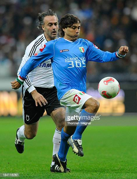 Maurizio Gaudino of Germany battles for the ball with Antonio Benarrivo of Italy during the century match between Germany and Italy at Commerzbank...