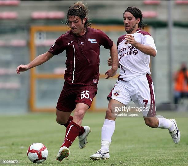 Maurizio Lanzaro of Reggina Calcio is challenged by Fabio Giordano of AS Cittadella during the Serie B match between Reggina Calcio and Cittadella at...