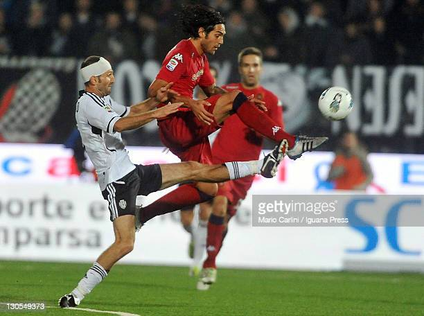 Maurizio Lauro of AC Cesena competes the ball with Joaquin Larrivey of Cagliari Calcio during the Serie A match between AC Cesena and Cagliari Calcio...