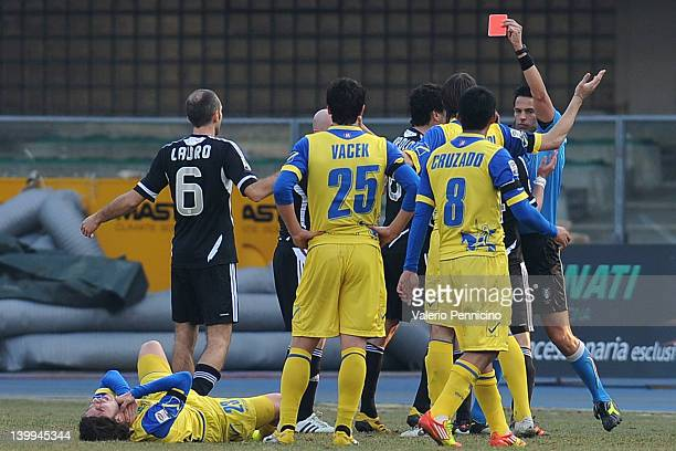 Maurizio Lauro of AC Cesena receives the red card from referee Andrea De Marco during the Serie A match between AC Chievo Verona and AC Cesena at...