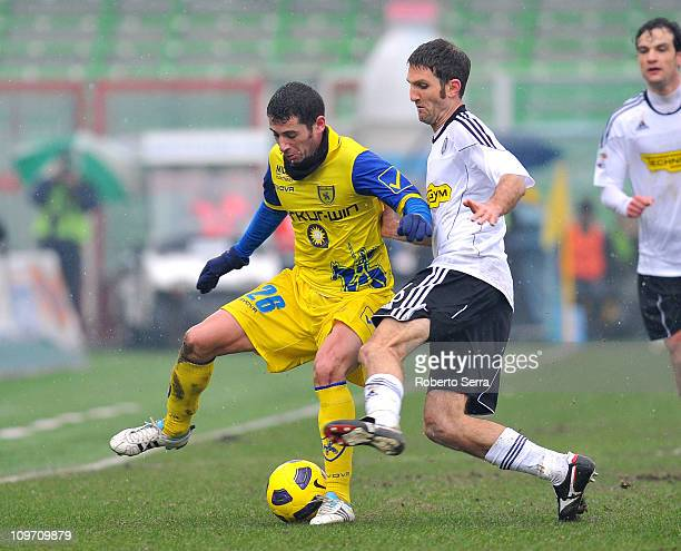 Maurizio Lauro of Cesena competes with Mariano Bogliacino of Chievo Verona during the Serie A match between AC Cesena and AC Chievo Verona at Dino...
