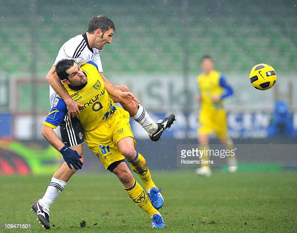 Maurizio Lauro of Cesena competes with Sergio Pellissier of Chievo Verona during the Serie A match between AC Cesena and AC Chievo Verona at Dino...