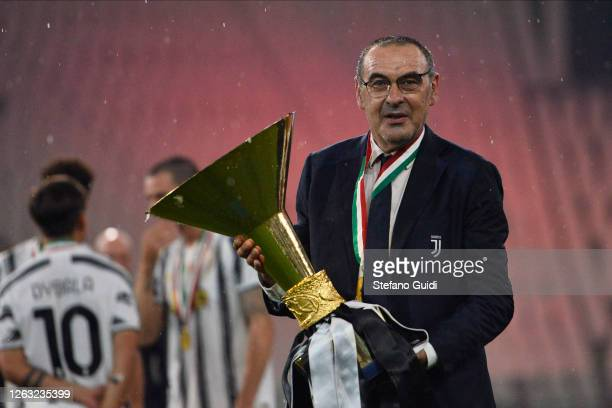 Maurizio Sarri ,Coach of Juventus FC, celebrates with the trophy after winning the Serie A Championship 2019-2020during the Serie A match between...