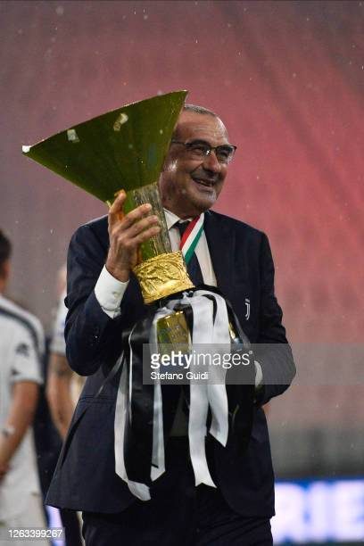 Maurizio Sarri Coach of Juventus FC celebrates with the trophy after winning the Serie A Championship 2019-2020during the Serie A match between...