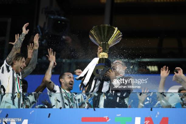 Maurizio Sarri Head coach of Juventus celebrates with the scudetto as he is sprayed with champagne by Wojciech Szczesny following the Serie A match...