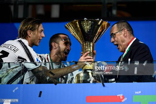Maurizio Sarri , head coach of Juventus FC, celebrates with the trophy during the award ceremony for Serie A 2019-2020 title at end of the Serie A...