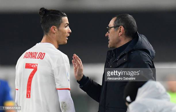 Maurizio Sarri head coach of Juventus issues instructions to Cristiano Ronaldo of Juventus during the Serie A match between Hellas Verona and...