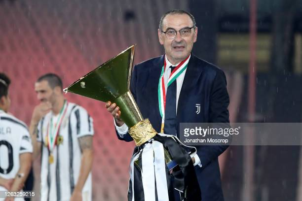 Maurizio Sarri, head coach of Juventus, poses with the trophy following the Serie A match between Juventus and AS Roma at on August 01, 2020 in...