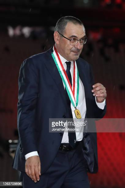 Maurizio Sarri Head coach of Juventus walks off the field of play wearing his winners' medal following the Serie A match between Juventus and AS Roma...