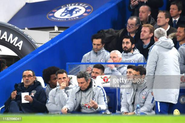Maurizio Sarri Manager of Chelsea and Kepa Arrizabalaga of Chelsea look on from the bench prior to the Premier League match between Chelsea FC and...