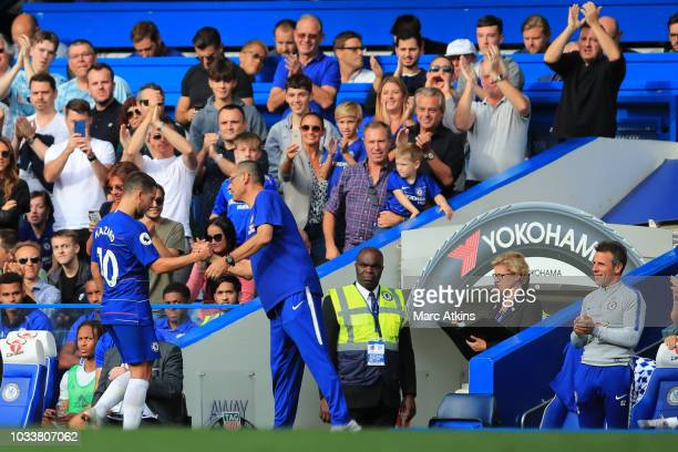 Maurizio Sarri manager of Chelsea congratulates Eden Hazard on his hattrick as fans and coaching staff give a standing ovation during the Premier...