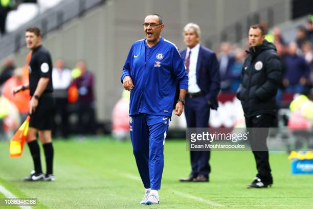 Maurizio Sarri Manager of Chelsea gives his team instructions during the Premier League match between West Ham United and Chelsea FC at London...