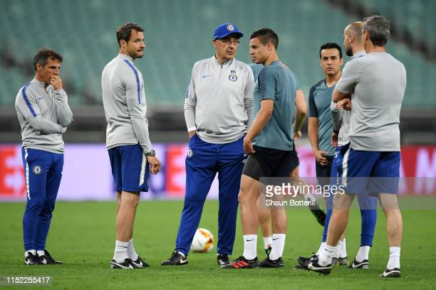 Maurizio Sarri Manager of Chelsea looks on with Cesar Azpilicueta Gianfranco Zola and Carlo Cudicini during the Chelsea FC training session on the...