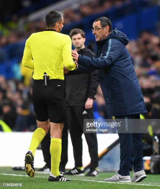 Maurizio Sarri Manager of Chelsea speaks to referee Slavko Vincic during the UEFA Europa League Round of 16 First Leg match between Chelsea and...