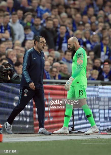 Maurizio Sarri manager of Chelsea walks past Willy Caballero of Chelsea as he tries to use him to replace Kepa Arrizabalaga during the Carabao Cup...