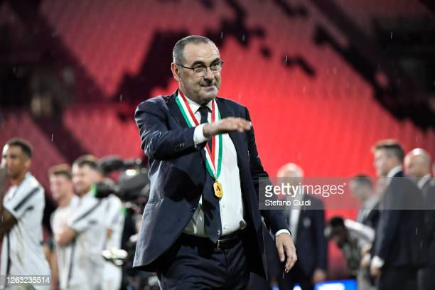 Maurizio Sarri, manager of Juventus FC, celebrates with the team after the Serie A match between Juventus and AS Roma at Allianz Stadium on August 1,...