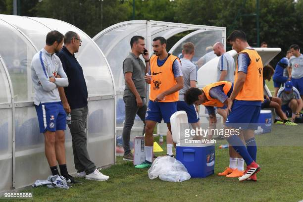 Maurizio Sarri of Chelsea with Carlo Cudicini and Davide Zappacosta during a training session at Chelsea Training Ground on July 14 2018 in Cobham...