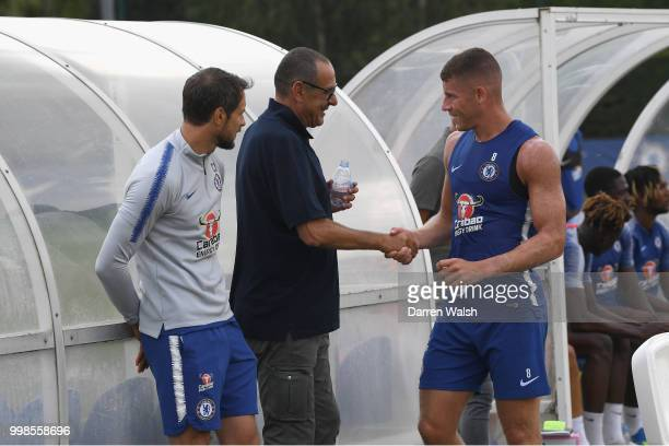 Maurizio Sarri of Chelsea with Carlo Cudicini and Ross Barkley during a training session at Chelsea Training Ground on July 14 2018 in Cobham England