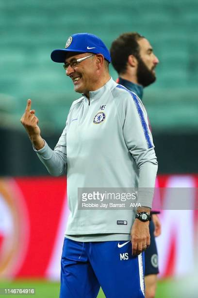 Maurizio Sarri the head coach / manager of Chelsea gestures towards Ross Barkley of Chelsea during the Chelsea training session prior to the UEFA...