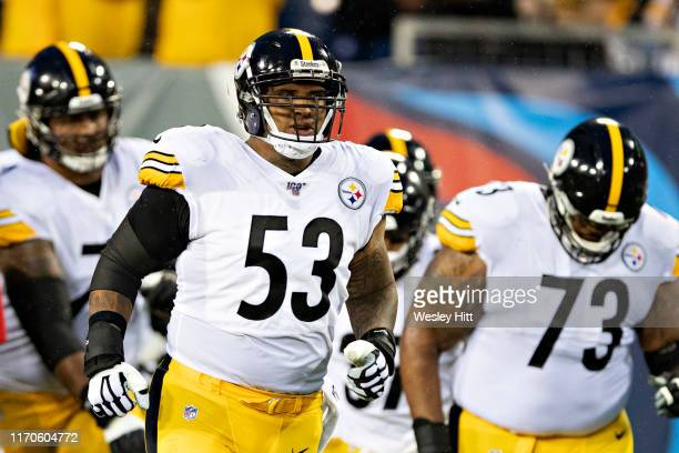 Maurkice Pouncey of the Pittsburgh Steelers jogs onto the field before a game against the Tennessee Titans during week three of preseason at Nissan...