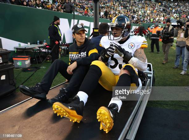 Maurkice Pouncey of the Pittsburgh Steelers leaves the game with an injury against the New York Jets during their game at MetLife Stadium on December...