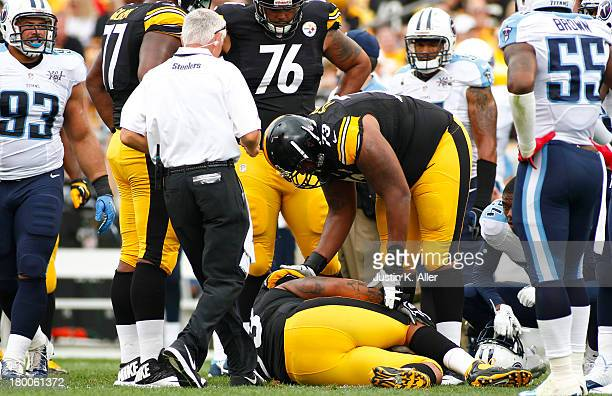 Maurkice Pouncey of the Pittsburgh Steelers lies injured on the ground in the first half against the Tennessee Titans during the game on September 8...
