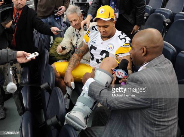Maurkice Pouncey of the Pittsburgh Steelers shows NFL Network's Deion Sanders his injured left ankle during Super Bowl XLV Media Day ahead of Super...