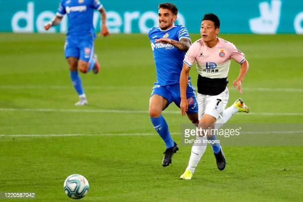 Mauro Arambarri of FC Getafe and Wu Lei of Espanyol Barcelona battle for the ball during the Liga match between Getafe CF and RCD Espanyol at...