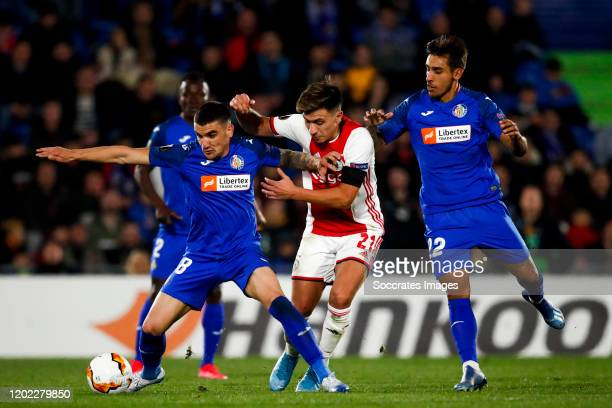 Mauro Arambarri of Getafe CF Lisandro Martinez of Ajax Damian Suarez of Getafe CF during the UEFA Europa League match between Getafe v Ajax at the...