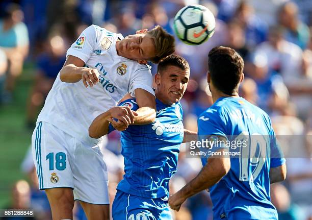 Mauro Arambarri of Getafe competes for the ball with Marcos Llorente of Real Madrid during the La Liga match between Getafe and Real Madrid at...