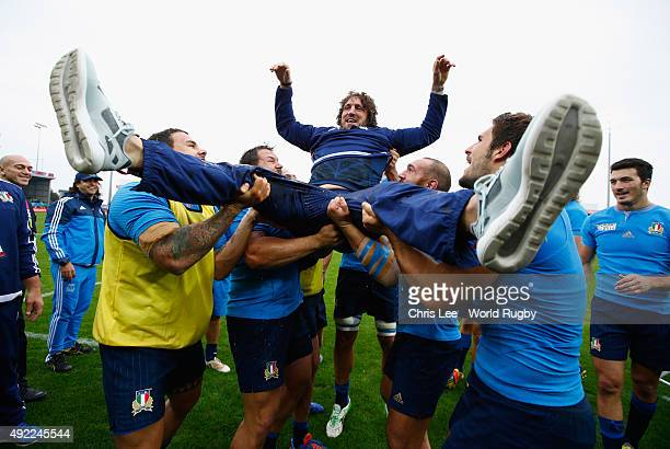 Mauro Bergamasco of Italy is thrown in the air by team mates after his last World Cup match during the 2015 Rugby World Cup Pool D match between...