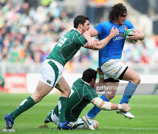 Mauro Bergamasco of Italy tries to break free from Robert Kearney and David Wallace of Ireland during the RBS 6 Nations Championship match between...