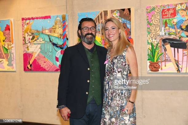 Mauro Bergonzoli and his partner Franziska FuggerBabenhausen during a vernissage with artwork by artist Mauro Bergonzoli at the new building otto by...
