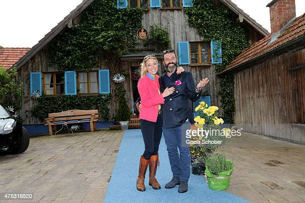 Mauro Bergonzoli and his partner Franziska FuggerBabenhausen during the Mauro Bergonzoli Country Life Studio Opening on May 30 2015 in Kirchheim...