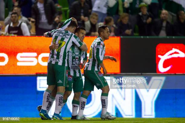 Mauro Beselli of Leon celebrates after scoring the first goal of his team with Fernando Navarro and Luis Montes during the 6th round match between...