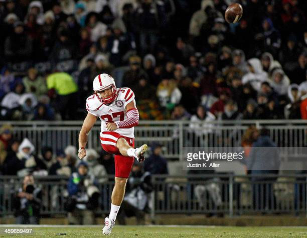 Mauro Bondi of the Nebraska Cornhuskers kicks off against the Penn State Nittany Lions during the game on November 23 2013 at Beaver Stadium in State...