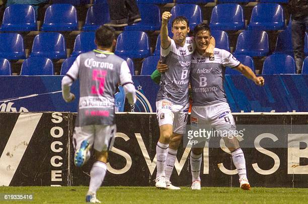 Mauro Boselli and German Cano of Leon celebrate their goal against Puebla, during their Mexican Apertura 2016 Tournament football match at the...
