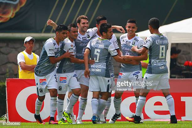 Mauro Boselli of Leon celebrates with teammates after scoring the first goal of his team during the 11th round match between Toluca and Leon as part...