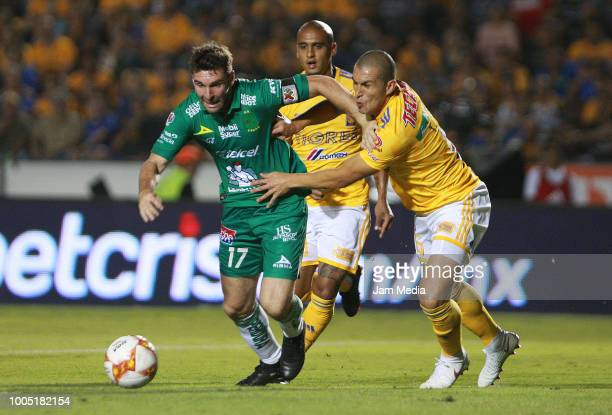 Mauro Boselli of Leon struggles for the ball against Jorge Torres of Tigres during the first round match between Tigres and Leon as part of the...