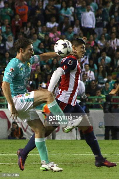 Mauro Boselli of Leon vies for the ball with Alan Pulido of Guadalajara during their Mexican Clausura 2016 Tournament football match at Nou Camp...