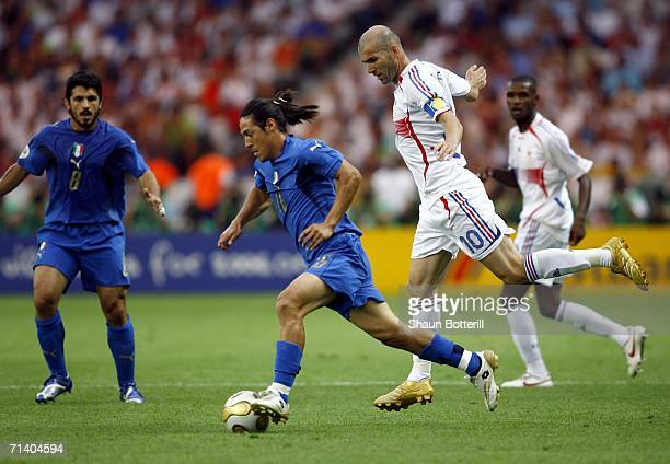 Mauro Camoranesi of Italy evades Zinedine Zidane of France during the FIFA World Cup Germany 2006 Final match between Italy and France at the Olympic...