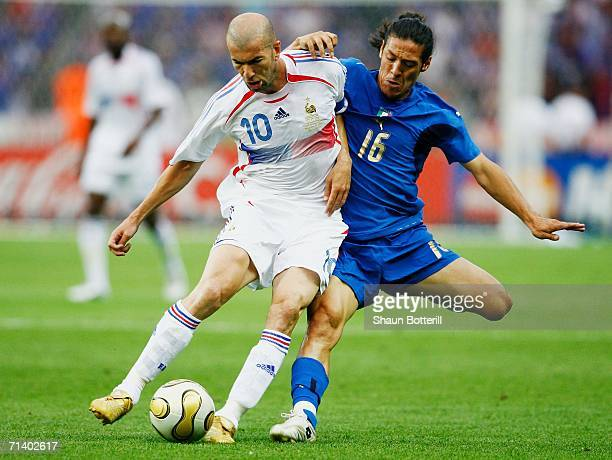 Mauro Camoranesi of Italy fights for the ball with Zinedine Zidane of France during the FIFA World Cup Germany 2006 Final match between Italy and...