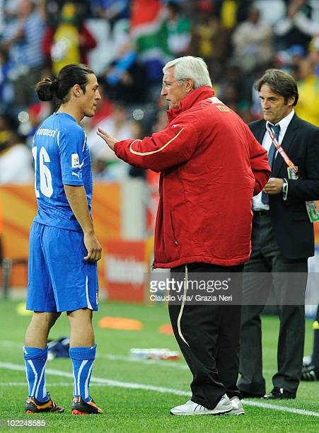 Mauro Camoranesi of Italy receives instructions from head coach Marcello Lippi during the 2010 FIFA World Cup South Africa Group F match between...