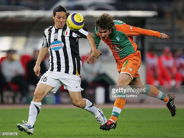 Mauro Camoranesi of Juventus battles with Christian Schulz of Werder Bremen during the UEFA Champions League First Knock-Out Round Second Leg match...