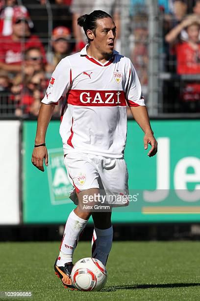 Mauro Camoranesi of Stuttgart runs with the ball during the Bundesliga match between SC Freiburg and VfB Stuttgart at the Badenova Stadium on...