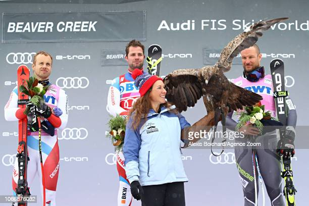 Mauro Caviezel of Switzerland takes 2nd place Beat Feuz of Switzerland takes 1st place Aksel Lund Svindal of Norway takes 3rd place during the Audi...