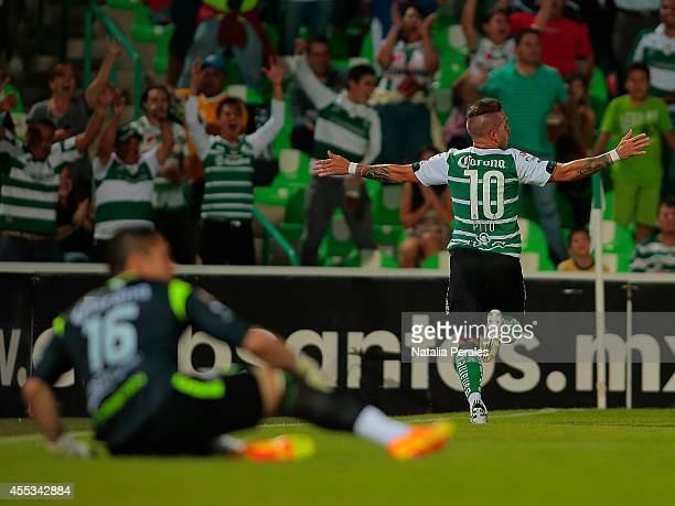Mauro Cejas celebrates after scoring during a match between Santos Laguna and Leon as part of 8th round Apertura 2014 Liga MX at Corona Stadium on...