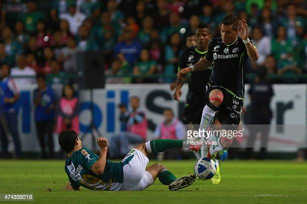 Mauro Cejas of Santos struggles for the ball with Jonny Magallon of Leon during a match between Leon and Santos Laguna as part of the Clausura 2014...