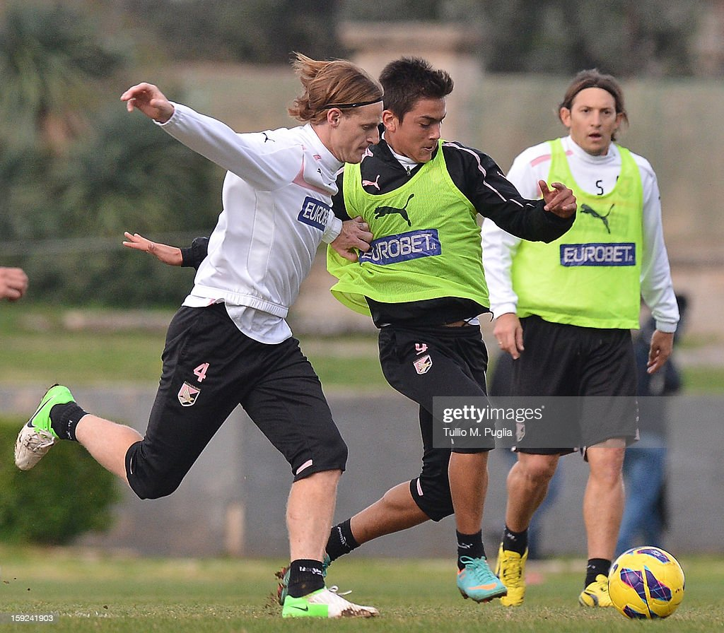 Mauro Cetto (L) and Paulo Dybala of Palermo in action during a training session at Tenente Carmelo Onorato Sports Center on January 10, 2013 in Palermo, Italy.