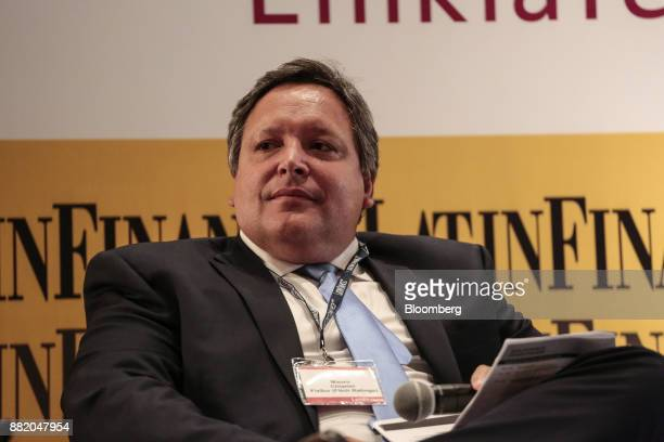 Mauro Chiarini senior director of Fitch Ratings Ltd listens during the Argentina SubSovereign and Infrastructure Finance Summit in Buenos Aires...